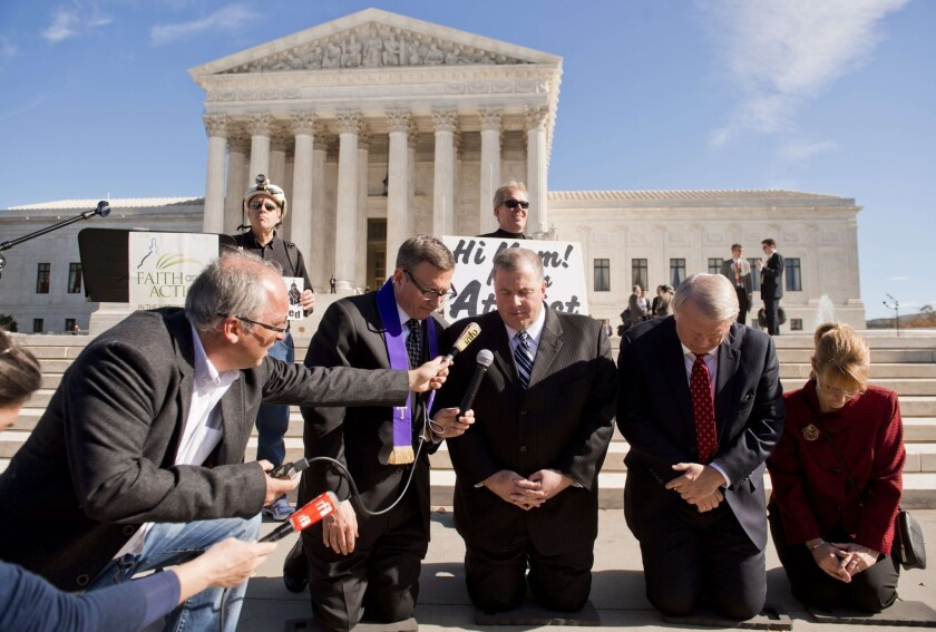 Dispute over prayer at meetings confounds Supreme Court