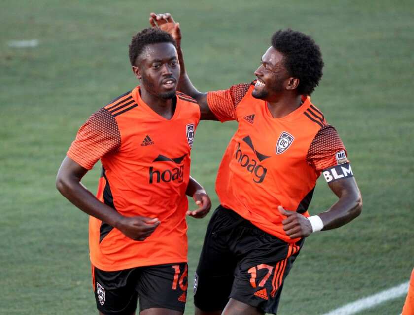 Orange County Soccer Club player Kevin Coleman, left, is congratulated by Darwin Jones, right.