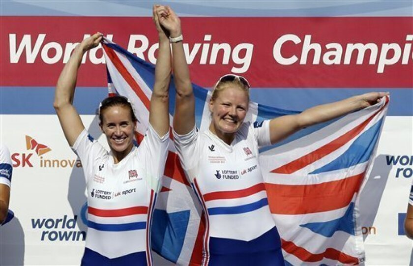 Winners Helen Glover, left, and Polly Swann of England celebrate during a medal ceremony for the women's pair final event of the World Rowing Championships in Chungju, south of Seoul, South Korea, Saturday, Aug. 31, 2013. (AP Photo/Lee Jin-man)