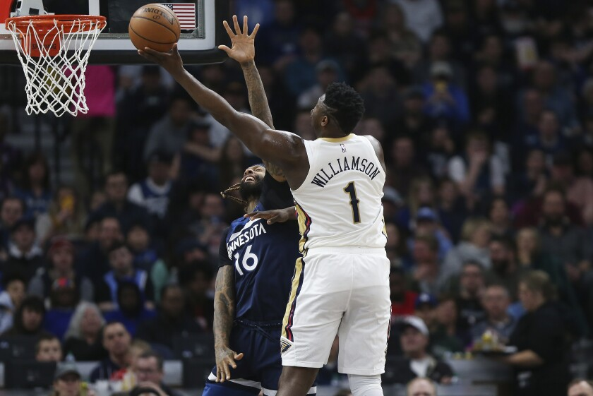 New Orleans Pelicans' Zion Williamson (1) shoots over Minnesota Timberwolves' James Johnson in the first half of an NBA basketball game Sunday, March 8, 2020, in Minneapolis. (AP Photo/Stacy Bengs)
