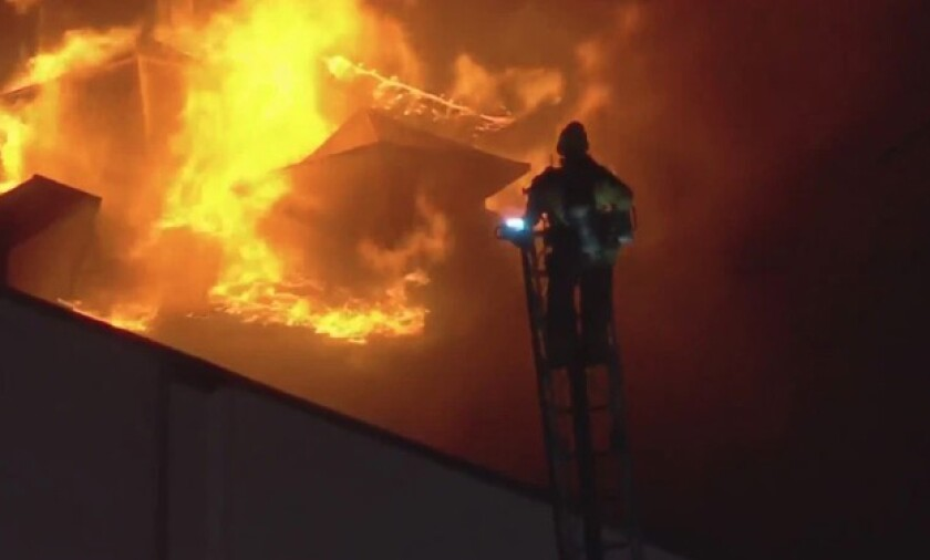 Firefighters battles a one-story blaze in downtown Los Angeles on Friday.