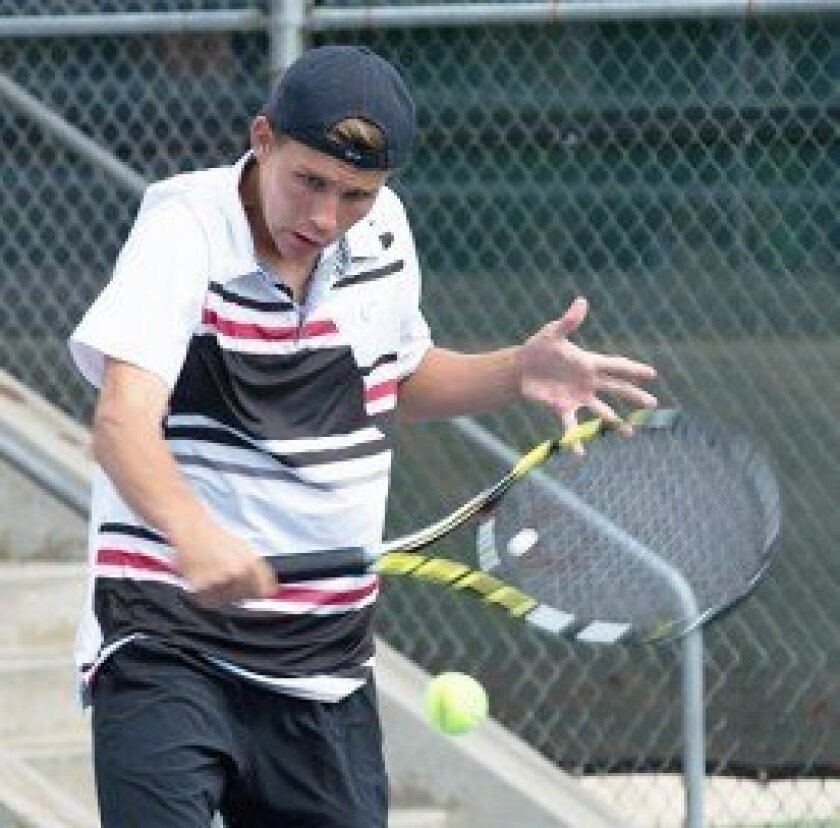 Sophomore Trenton Fudge leans into his backhand with finesse and concentration during playoff week. Photos by Ed Piper
