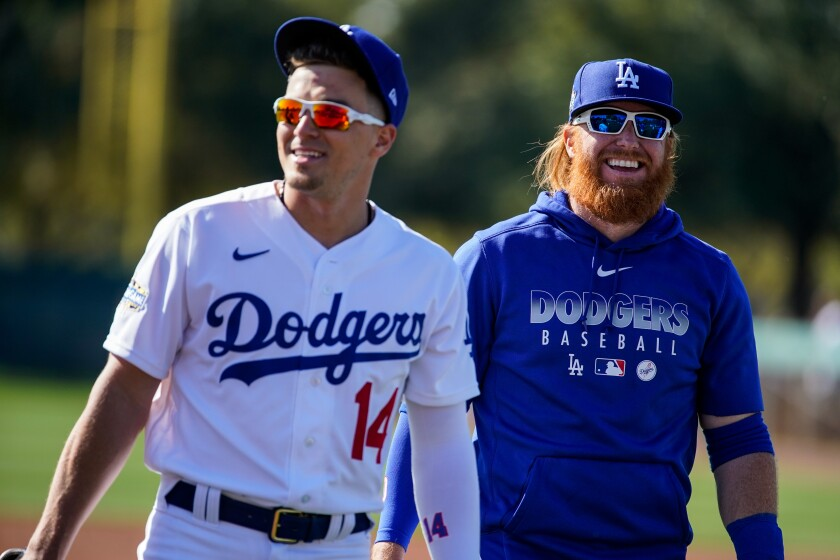 Dodgers teammates Kiké Hernández, left, and Justin Turner walk off the field after practice at Camelback Ranch on Feb. 20.