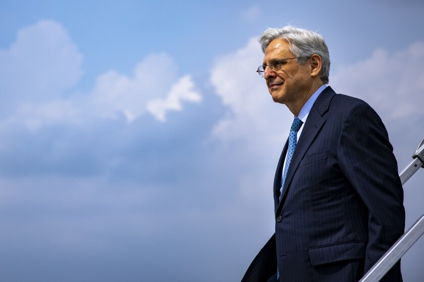 Attorney General Merrick Garland arrives at Midway International Airport in Chicago, Thursday, July 22, 2021. Garland announced an initiative to reduce gun violence with five cross-jurisdictional strike forces by disrupting illegal firearms trafficking in key regions across the United States. (Samuel Corum/Pool via AP)