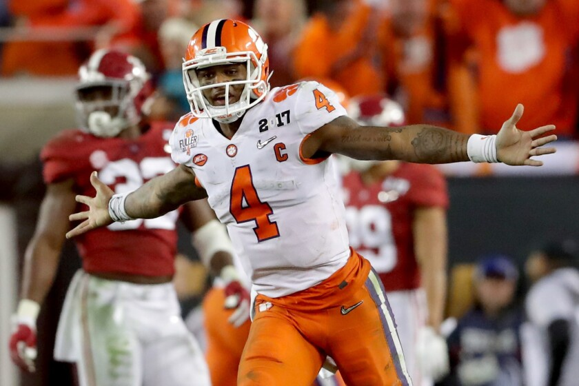 Quarterback Deshaun Watson (4) of the Clemson Tigers celebrates after throwing a 2-yard game-winning touchdown pass during the fourth quarter against the Alabama Crimson Tide to win the 2017 College Football Playoff National Championship Game 35-31.