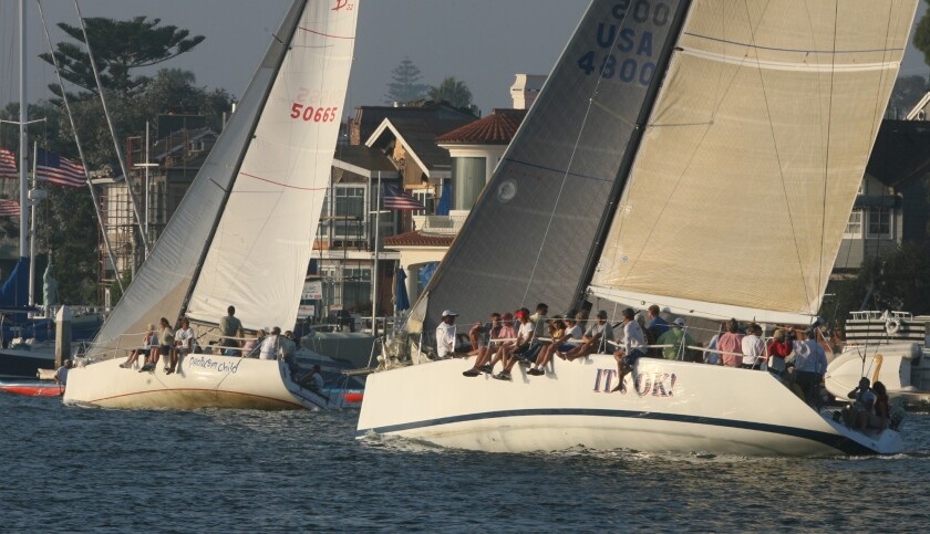 PARTY BOATS – Sailing vessels in the Beer–Can Regattas let thier feet hang loose over the sides as t