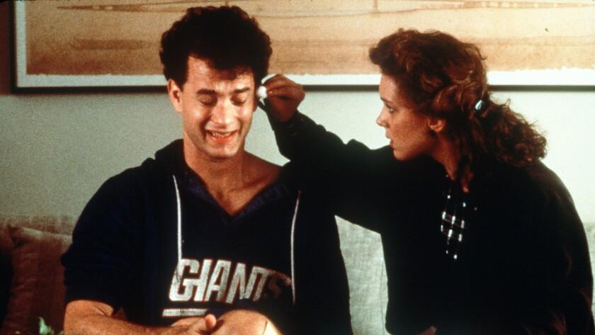 "Tom Hanks and Elizabeth Perkins in the 1988 movie ""Big."""
