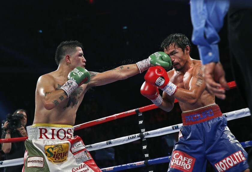 Brandon Rios lands a left jab against Manny Pacquiao during a bout on Nov. 24, 2013. Rios lost that bout, and a 2015 match with Timothy Bradley Jr. that led him to retire for almost two years.