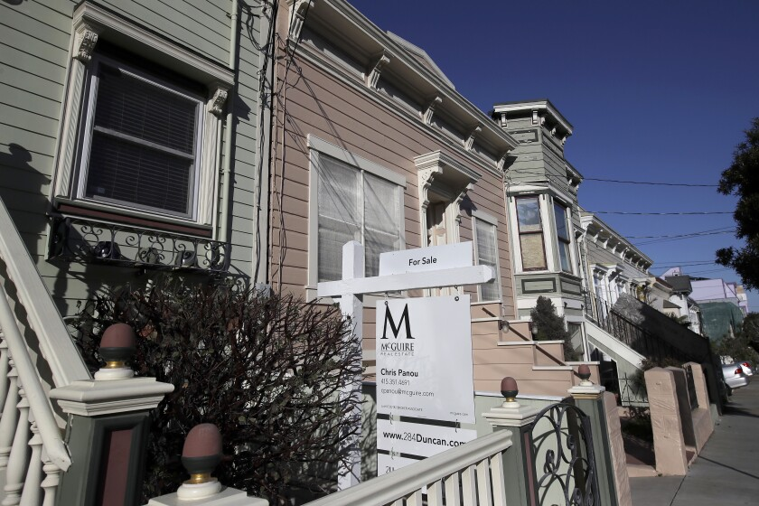 This Feb. 18, 2020, photo shows a real estate sign in front of a home for sale in San Francisco. On Thursday, Feb. 27, Freddie Mac reports on this week's average U.S. mortgage rates. (AP Photo/Jeff Chiu)