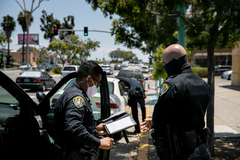 San Diego Police Department officers make a traffic stop.