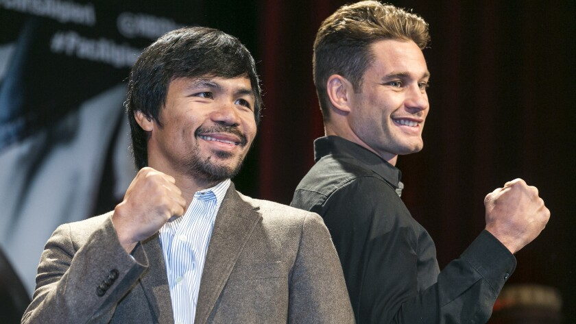 Boxers Manny Pacquiao, left, and Chris Algieri pose for photos during a news conference in Los Angeles on Wednesday. Pacquiao and Algieri are scheduled to fight in Macau on Nov. 22.