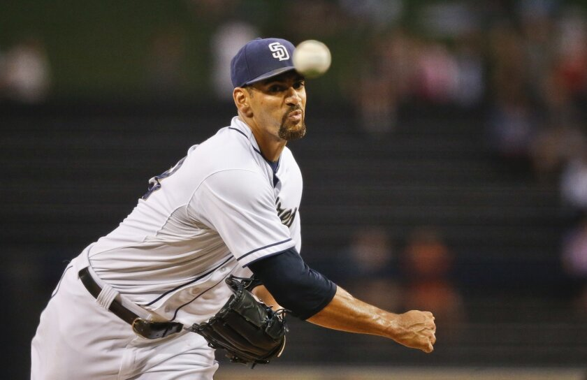 FILe - In this Aug. 31, 2015, file photo, San Diego Padres starting pitcher Tyson Ross works against the Texas Rangers in the first inning of a baseball game, in San Diego. New manager Andy Green has picked Tyson Ross as the opening day starter against the defending NL West champion Los Angeles Dod