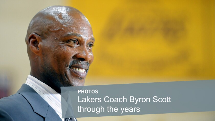 Lakers Coach Byron Scott smiles during his introductory news conference on July 29 at the team's training facility in El Segundo. Scott played for the Lakers for 11 seasons in the 1980s and '90s before returning this year to coach the team.