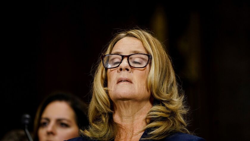 Christine Blasey Ford takes a breath at a Senate Judiciary Committee hearing on Capitol Hill in Washington on Sept. 27.