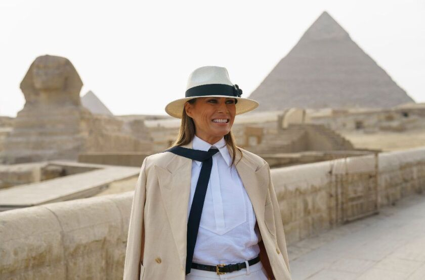 First lady Melania Trump visits the ancient statue of Sphinx, with the body of a lion and a human head, at the historic site of Giza Pyramids in Giza, near Cairo, Egypt, Saturday, Oct. 6, 2018.