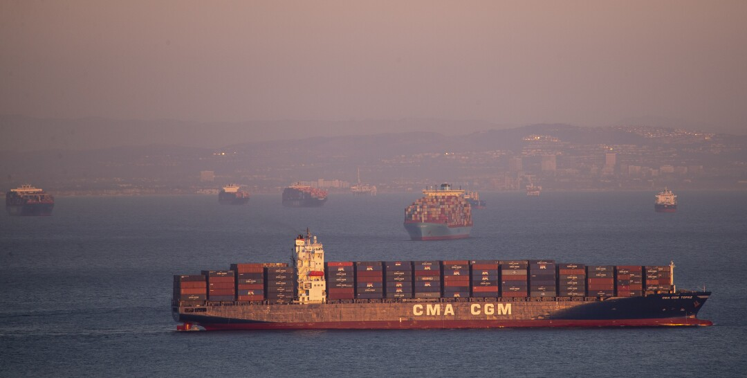 Dozens of container ships sit off the coast of the Ports of Los Angeles and Long Beach, waiting to be unloaded Wednesday.
