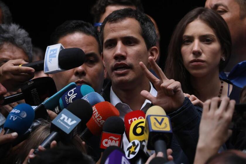 The president of Venezuela's National Assembly and self-proclaimed interim president of the country, Juan Guaido, speaks with the media in Caracas on Jan. 27, 2019. EFE-EPA