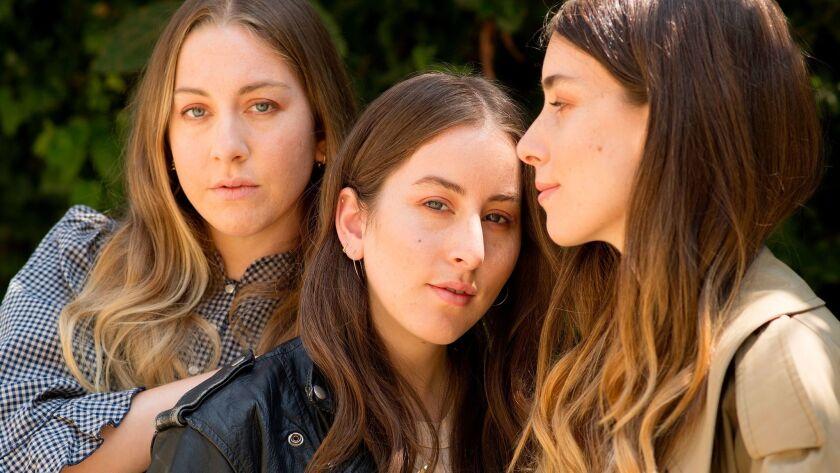 Sisters Este, from left, Alana and Danielle Haim of the L.A. pop group Haim.