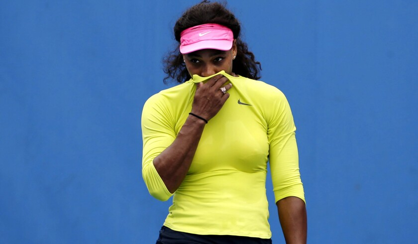 Serena Williams tries to stifle a cough during a practice session Saturday in Melbourne.