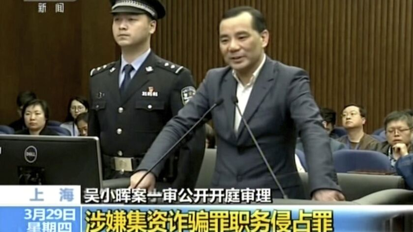 In this image taken from undated video run by China's CCTV, Wu Xiaohui, the former chairman of the Anbang Insurance Group, speaks during a court session at the Shanghai No. 1 Intermediate People's Court in Shanghai.