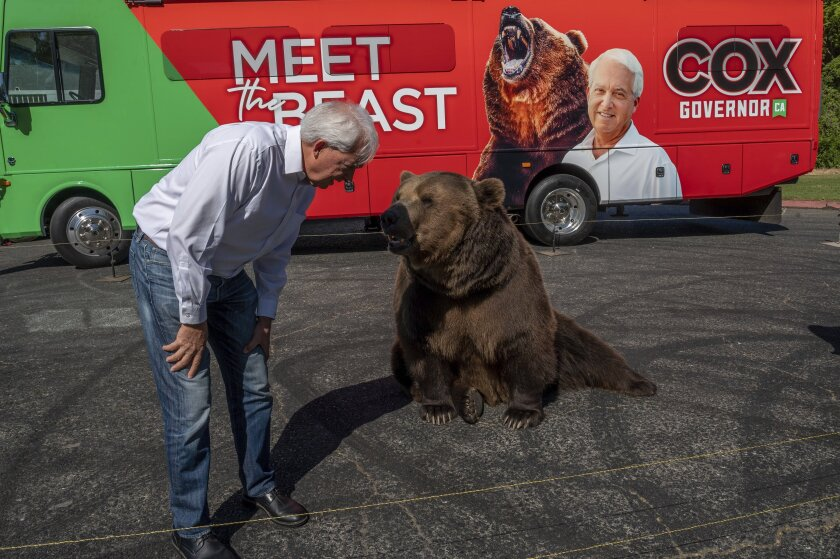"John Cox, Republican recall candidate for California governor, begins his statewide ""Meet the Beast"" bus tour on Tuesday, May 4, 2021, with Tag, a Kodiak brown bear, at Miller Regional Park in Sacramento. (Renee C. Byer/The Sacramento Bee via AP)"
