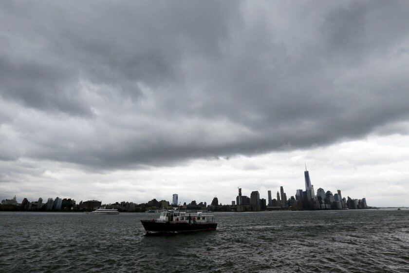 A boat passes Pier A Park on the Hudson River with the New York skyline in the background on Wednesday, Sept. 30, 2015, in Hoboken, N.J. Officials are taking precautions for the rest of the week as forecasters closely follow Hurricane Joaquin. (AP Photo/Julio Cortez)