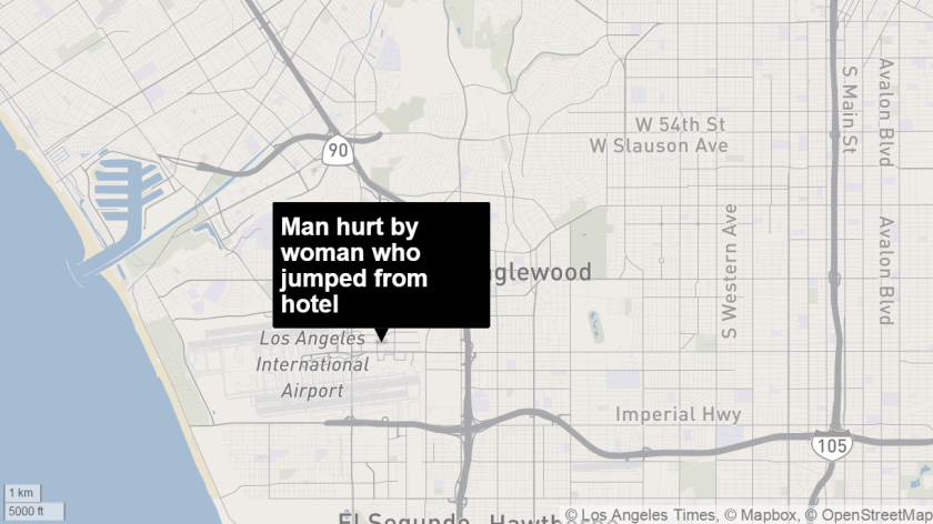 A man was critically injured after a woman who jumped from a hotel landed on him.
