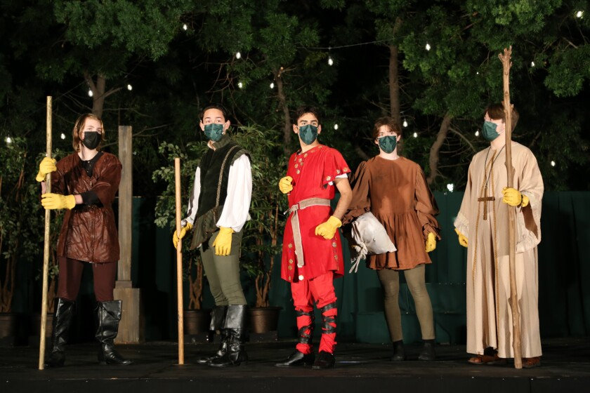 """Robin Hood and his Merry Men perform during the  production of """"Robin Hood and the White Arrow."""""""