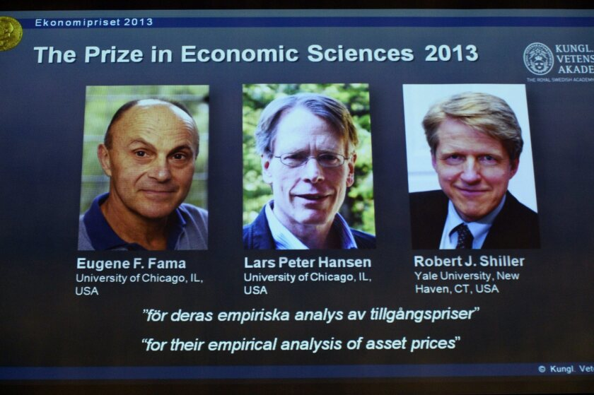 Pictures of the 2013 Nobel laureates in economic sciences -- Eugene Fama, Lars Peter Hansen and Robert Shiller, left to right -- are displayed on a screen during a news conference at the Royal Swedish Academy of Sciences in Stockholm.