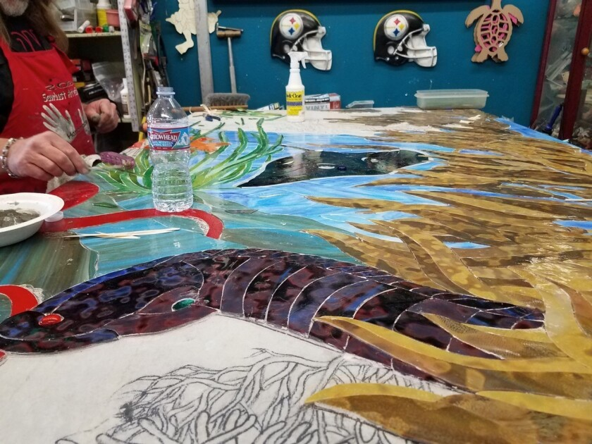 Work is about halfway complete on a new mosaic from the Surfing Madonna Oceans Project that will be installed on the $3 million Marine Safety Center at Moonlight Beach in Encinitas. (Su