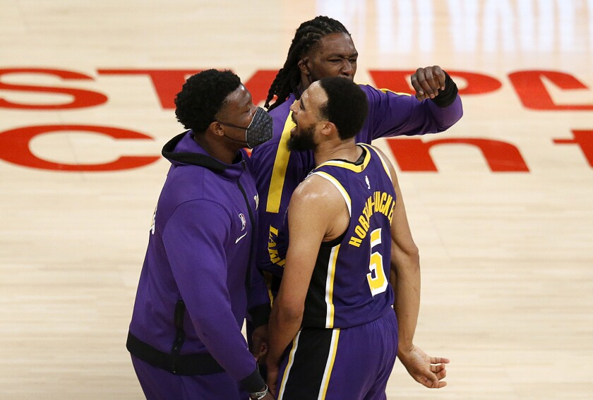 Lakers guard Talen Horton-Tucker celebrates with his teammates after a 101-99 overtime victory over the Knicks