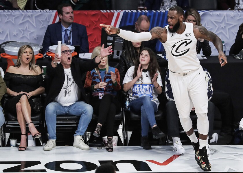 LeBron James reacts after making a three-pointer late in the second half at the NBA All-Star game at Staples Center.
