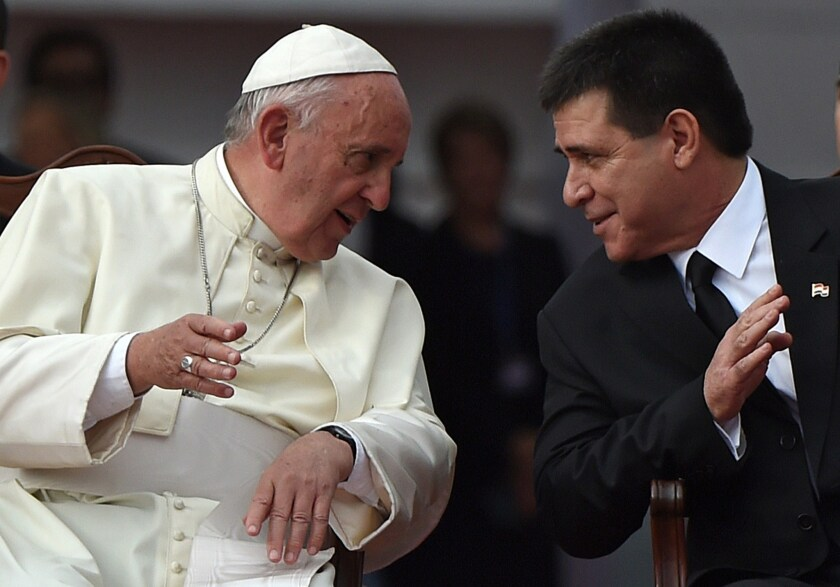 Pope Francis chats with Paraguay's President Horacio Cartes during the welcoming ceremony in Asuncion on July 10 .