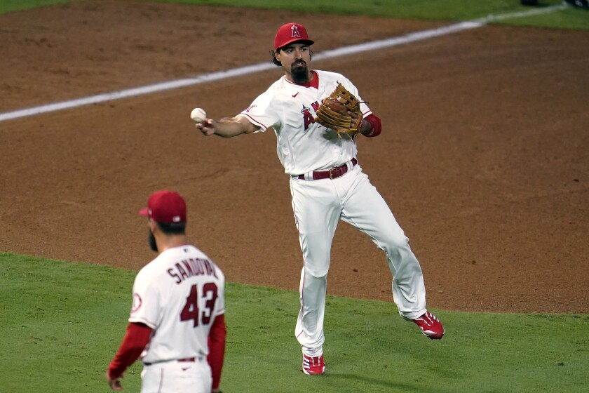 Angels third baseman Anthony Rendon makes an off-balance throw to put out the Diamondbacks' Nick Ahmed at first base.