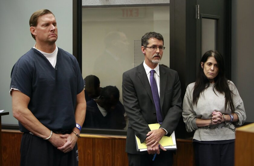 Michael Woodward, left, and his wife, Melissa Woodward, pleaded not guilty in Superior Court to charges that they bilked San Diego County seniors out of nearly $2 million in an insurance scam. With them is, Earll M. Pott, Melissa Woodward's attorney.