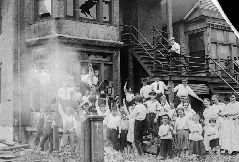 During the Red Summer of 1919, White children celebrate the burning of a Black building.