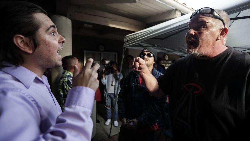 LOS ALAMITOS, CA, MONDAY, MARCH 19, 2018 - Paul Scott, left, and John Rodriguez argue over immigrati