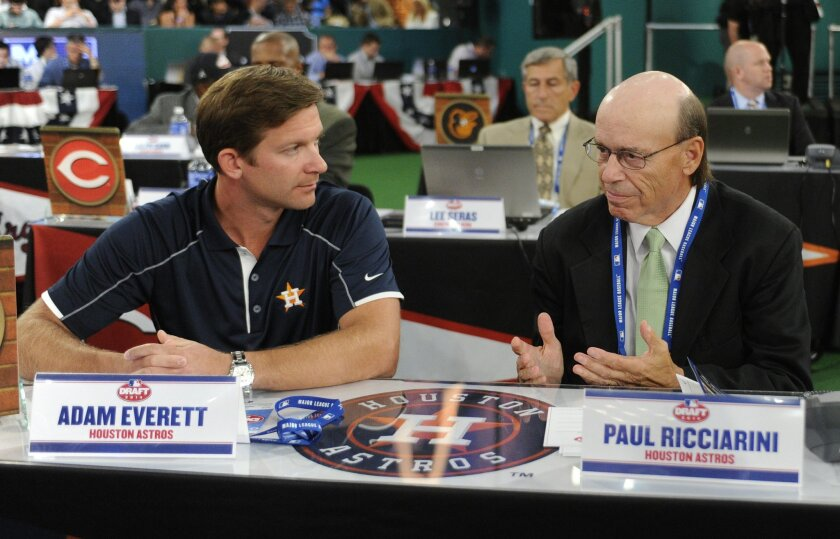 Houston Astros representatives Adam Everett, left, and Paul Ricciarini discuss who they are going to draft with the first pick in the 2014 MLB baseball draft Thursday, June 5, 2014, in Secaucus, N.J. The Astros chose Brady Aiken from San Diego, California. (AP Photo/Bill Kostroun)