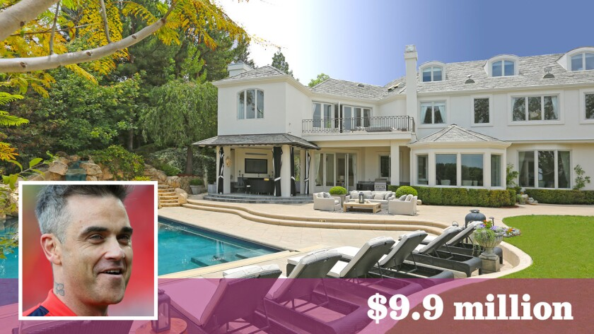 British singer Robbie Williams has sold his home in gated Mulholland Estates for $9.9 million.