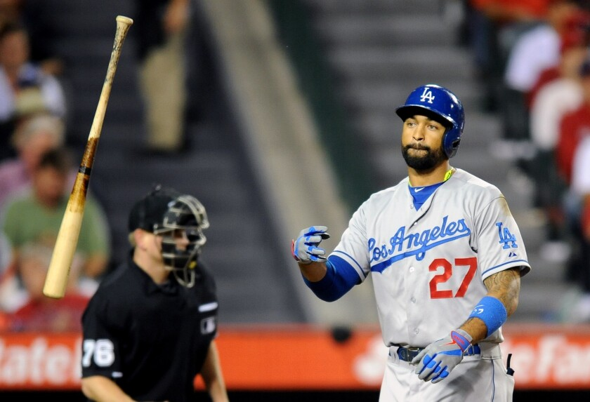 Dodgers center fielder Matt Kemp tosses his bat after striking out against the Angels in May. How will Kemp's absence affect the Dodgers' postseason?