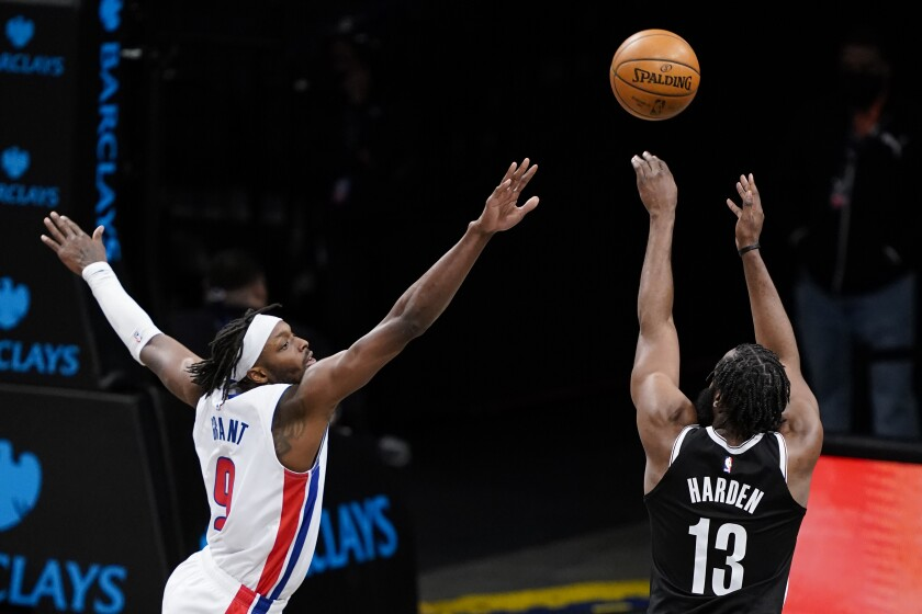 Brooklyn Nets guard James Harden (13) shoots as Detroit Pistons forward Jerami Grant (9) defends during the second half of an NBA basketball game Saturday, March 13, 2021, in New York. (AP Photo/John Minchillo)