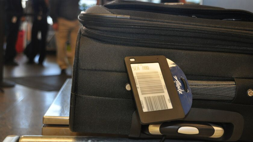Alaska Airlines and Virgin America want your carry-on bags to be 32