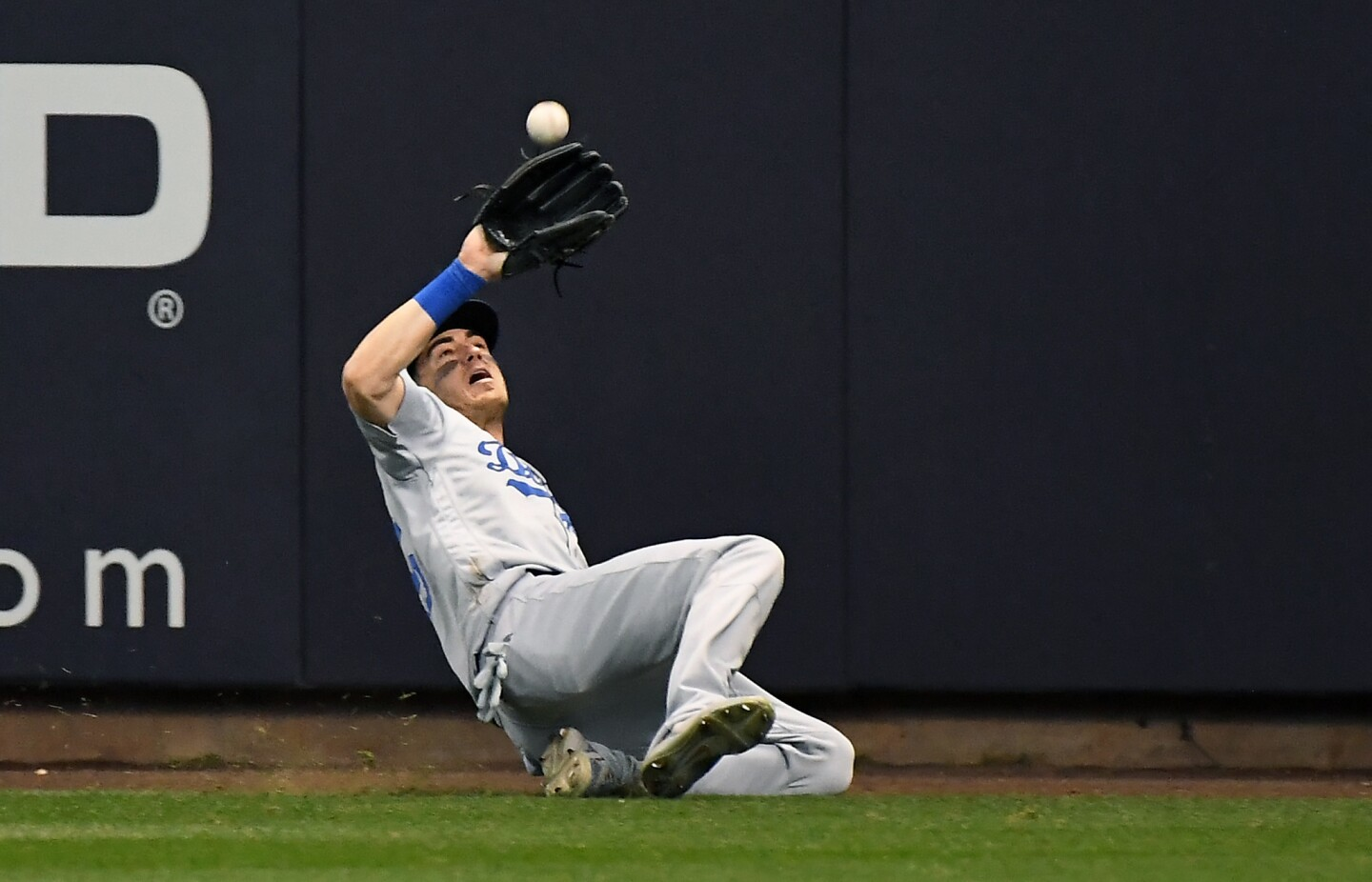 Dodgers Cody Bellinger makes a sliding catch off the bat of Brewers Ryan Braun in the 8th inning.