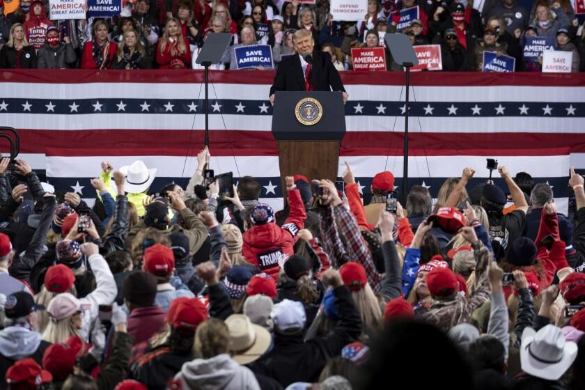 President Donald Trump addresses the crowd at a rally for U.S. Senators Kelly Loeffler, R-Ga., and David Perdue, R-Ga., who are both facing runoff elections Saturday, Dec. 5, 2020, in Valdosta, Ga. (AP Photo/Ben Gray)