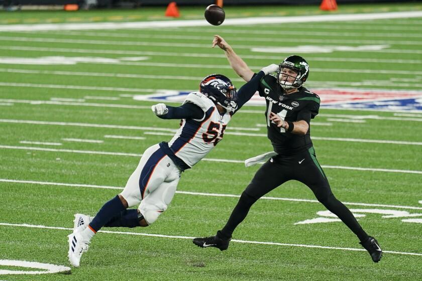 Denver Broncos outside linebacker Bradley Chubb (55) pressures New York Jets quarterback Sam Darnold (14) during the first half of an NFL football game Thursday, Oct. 1, 2020, in East Rutherford, N.J. (AP Photo/John Minchillo)
