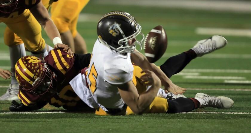 Ball pops away from El Camino quarterback Kiah Reid