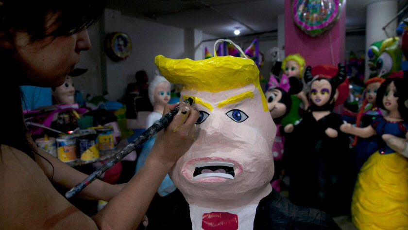 Alicia Lopez Fernandez paints a piñata of Donald Trump at her family's store in Mexico City in July 2015. Trump traveled to Mexico City on Wednesday to meet with Mexican President Enrique Peña Nieto.