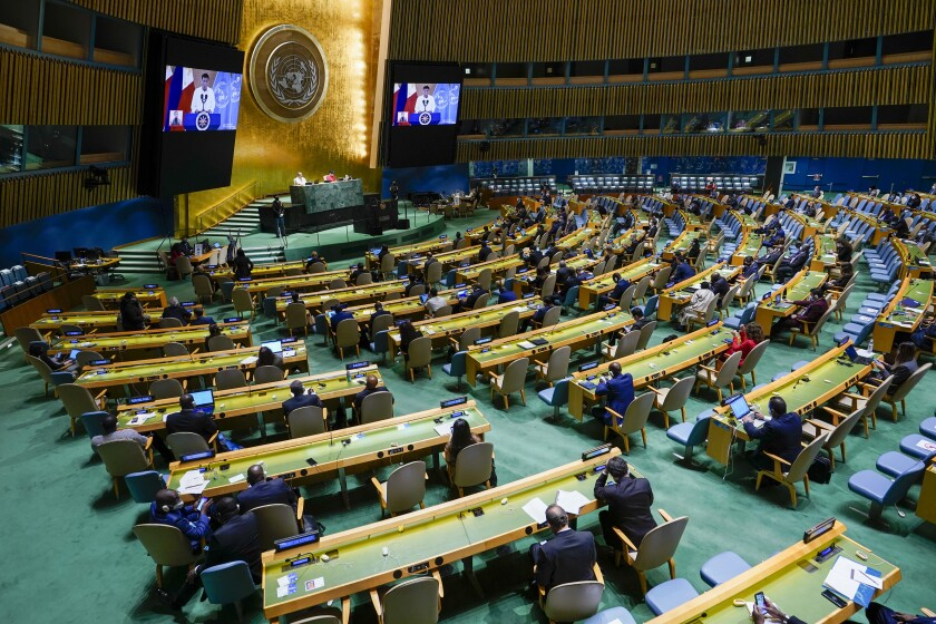 Philippines President Rodrigo Roa Duterte is seen on video screens as addresses the 76th Session of the United Nations General Assembly remotely, Tuesday, Sept. 21, 2021 at U.N. headquarters. (AP Photo/Mary Altaffer, Pool)