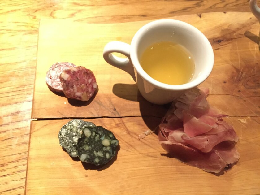 House-mad charcuterie with ham tea, a snack on the tasting menu at Juniper & Ivy.