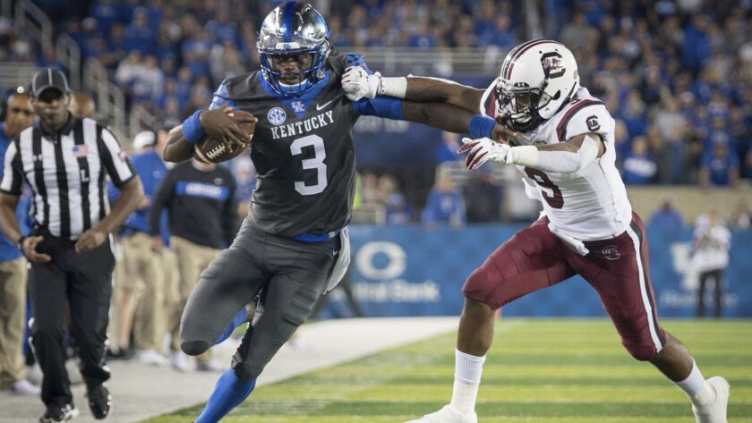 Kentucky quarterback Terry Wilson (3) is tackled by South Carolina defensive back Keisean Nixon (9)